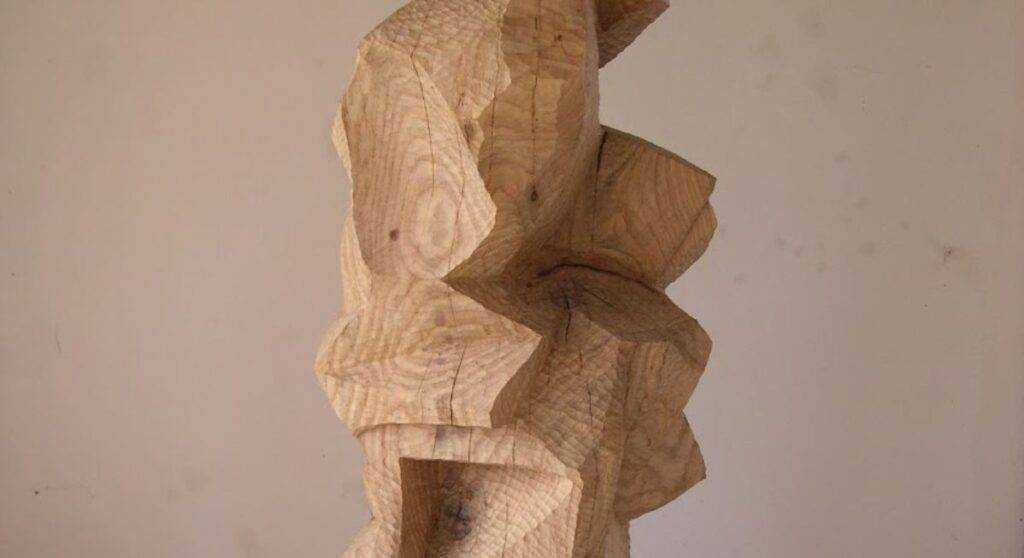 Detail image of a geometric wooden sculpture by Mike Slaski.